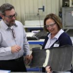 Sen. Deb Fischer inspects a composite part
